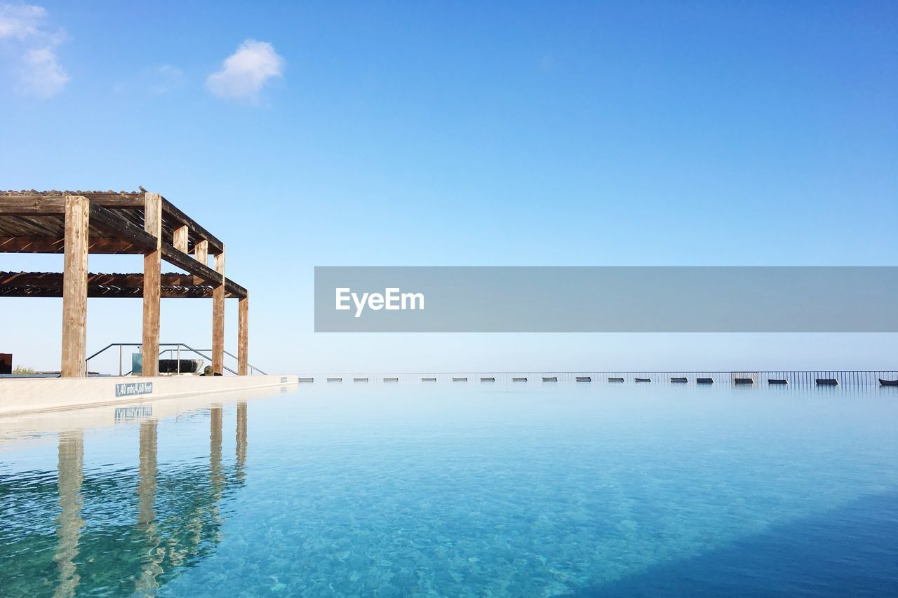 SWIMMING POOL AGAINST CLEAR BLUE SKY