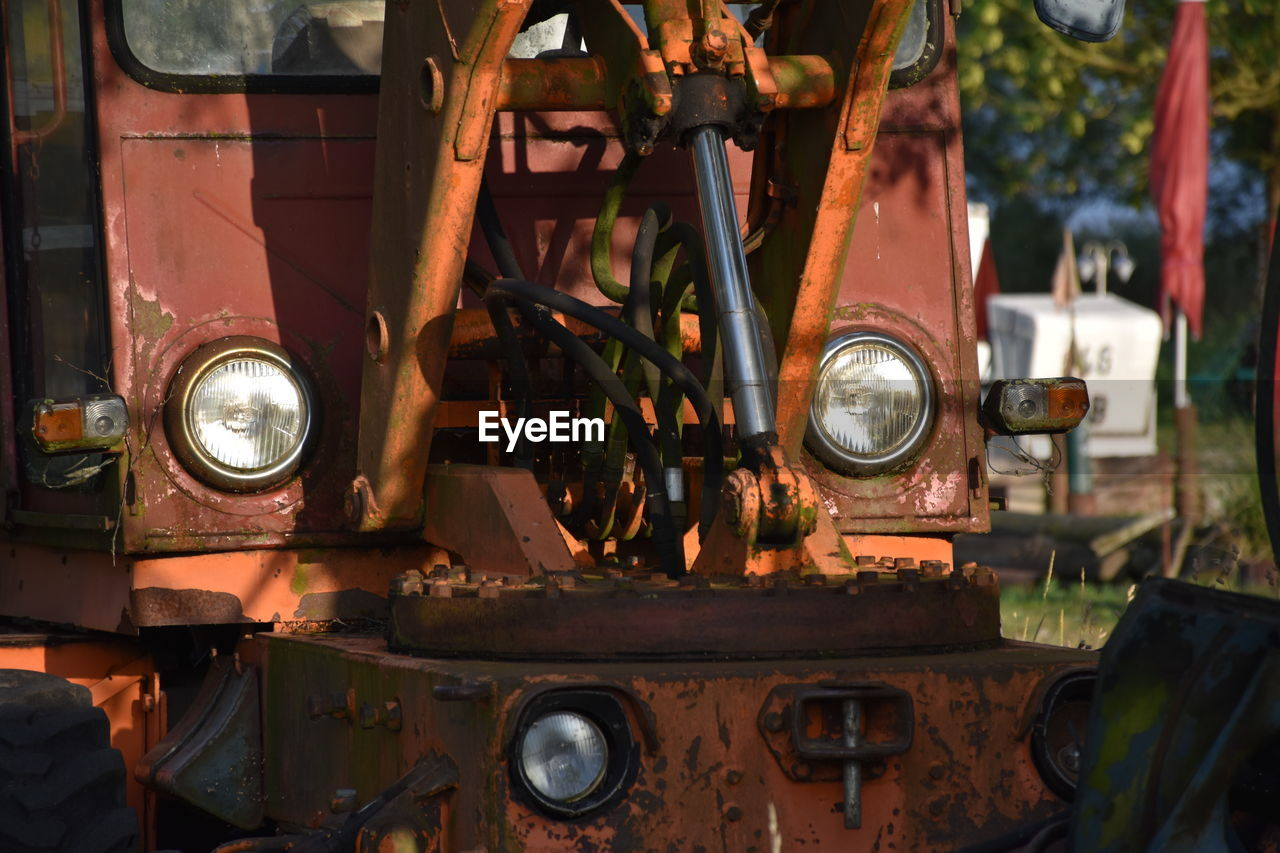 mode of transportation, transportation, land vehicle, agricultural machinery, metal, rusty, tractor, abandoned, headlight, day, motor vehicle, obsolete, car, agricultural equipment, retro styled, train - vehicle, rail transportation, train, machinery, no people, wheel, deterioration