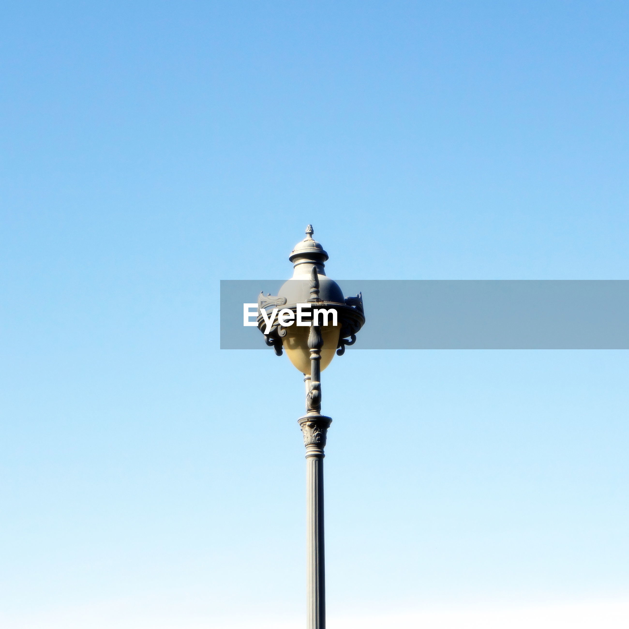Low angle view of antique street light against clear sky
