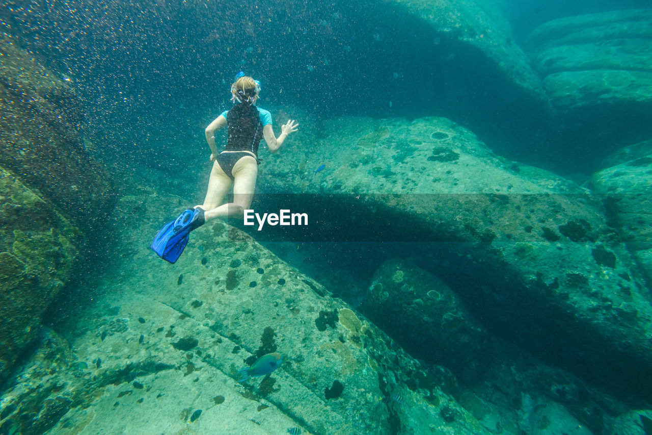 Full Length Of Woman Swimming In Sea