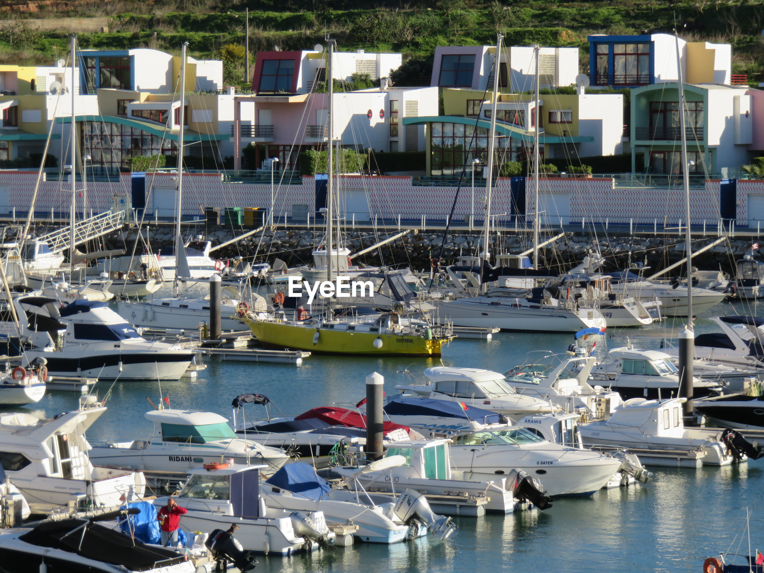 High angle view of yachts at harbor in city