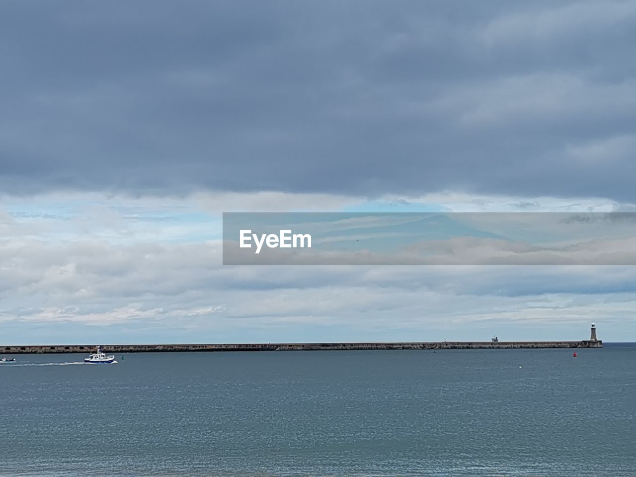 cloud - sky, sky, water, sea, scenics - nature, beauty in nature, nautical vessel, nature, tranquil scene, tranquility, day, waterfront, no people, transportation, outdoors, non-urban scene, architecture, idyllic