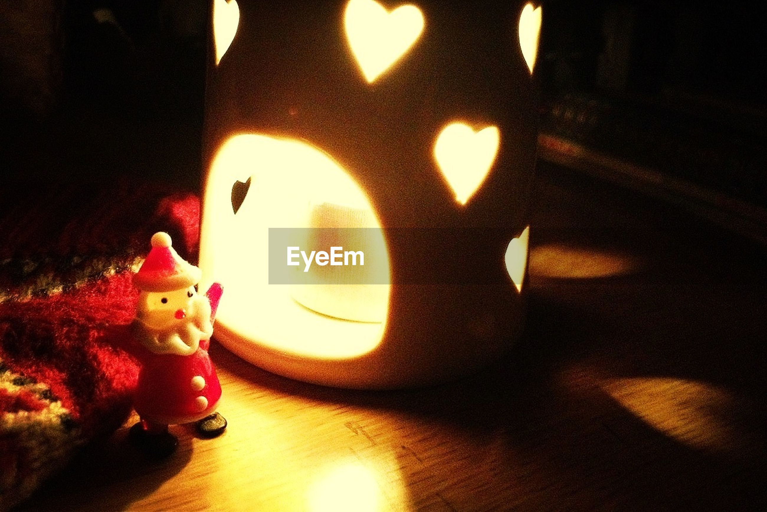 indoors, illuminated, human representation, art and craft, creativity, art, animal representation, close-up, still life, toy, candle, decoration, orange color, celebration, night, table, no people, anthropomorphic face, halloween