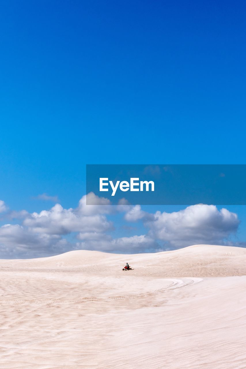 sky, desert, scenics - nature, land, sand, arid climate, climate, blue, landscape, beauty in nature, non-urban scene, tranquility, nature, day, tranquil scene, cloud - sky, environment, remote, sand dune, copy space, outdoors, salt flat
