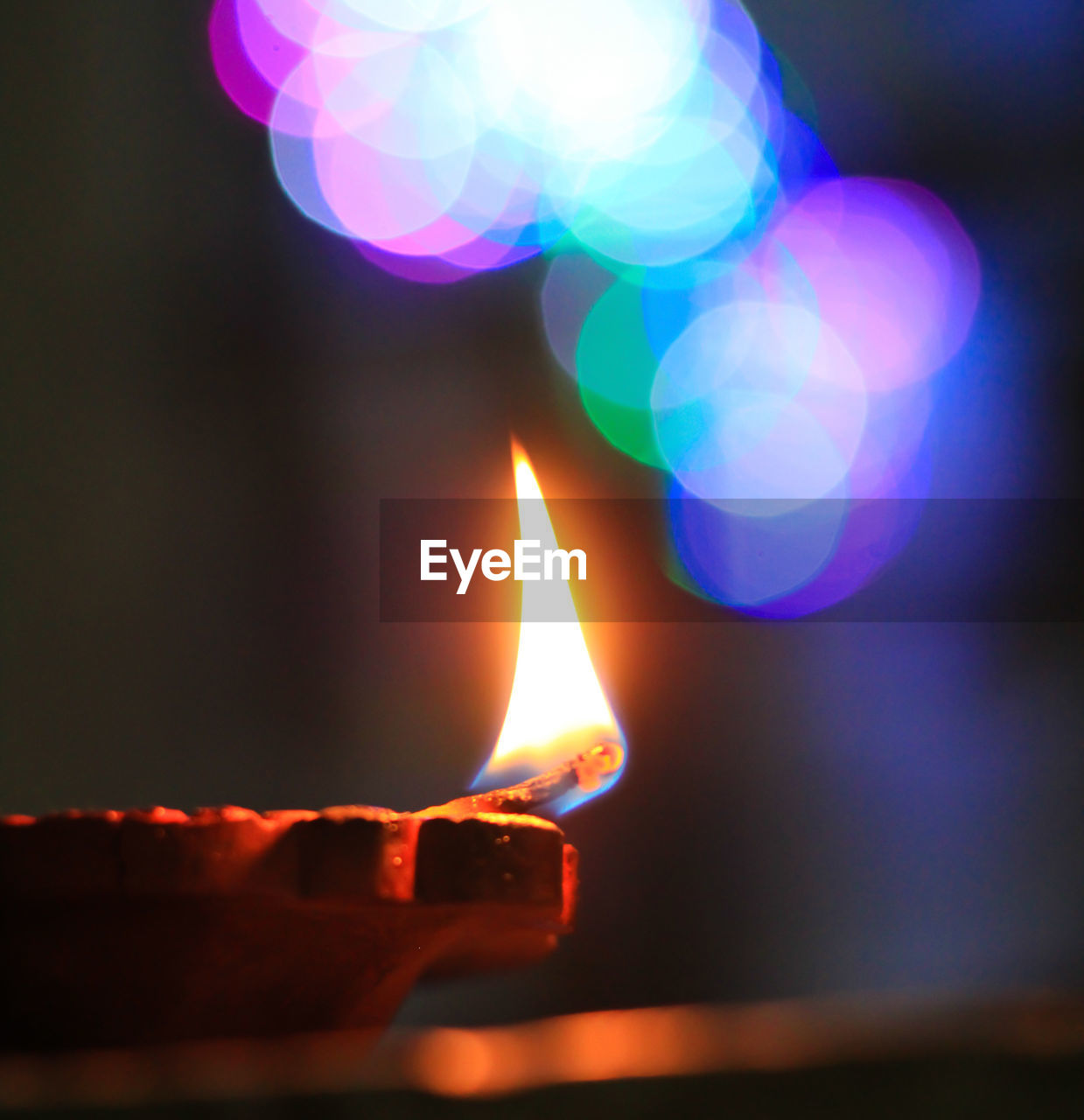 flame, burning, fire, illuminated, heat - temperature, glowing, fire - natural phenomenon, close-up, nature, no people, focus on foreground, lighting equipment, lens flare, light - natural phenomenon, indoors, celebration, oil lamp, night, selective focus, candle, electric lamp