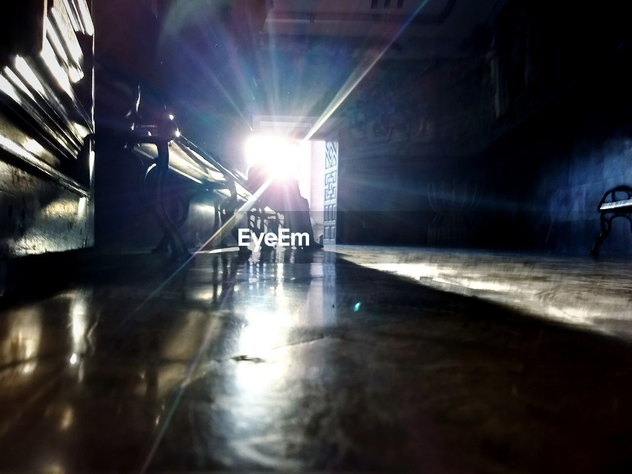 real people, men, sunlight, two people, indoors, standing, light beam, occupation, welder, transportation, low angle view, full length, illuminated, day, built structure, lifestyles, manual worker, women, low section, architecture, adult, people