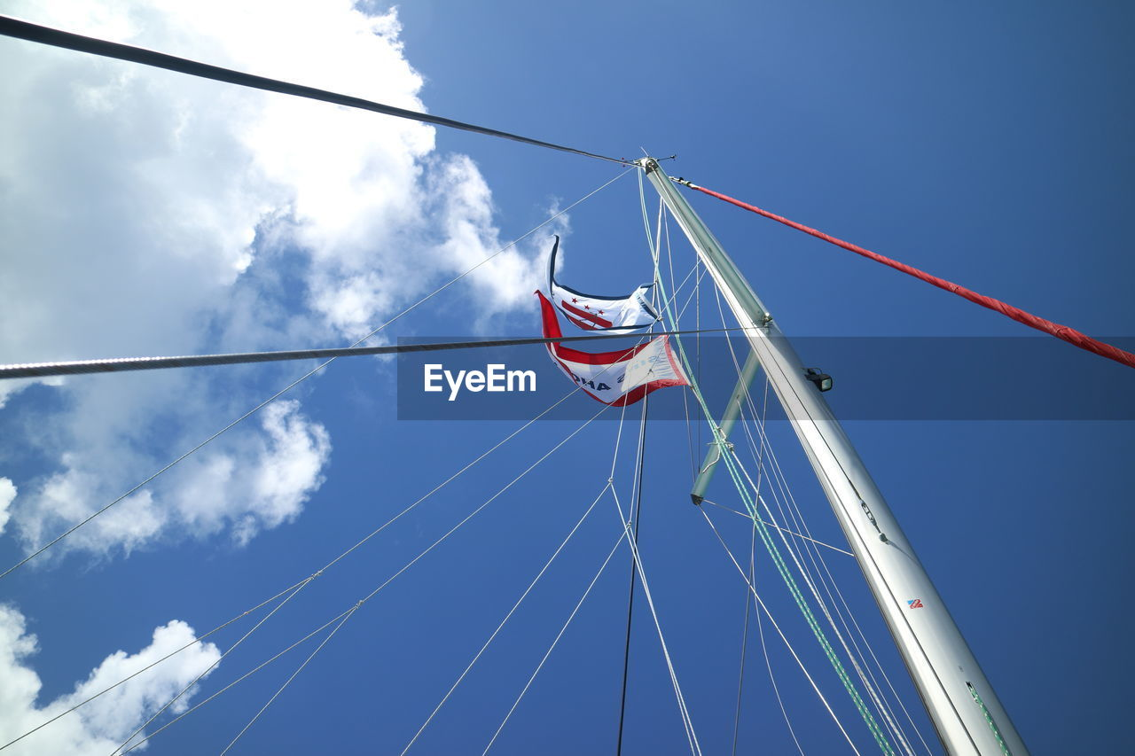 sky, patriotism, blue, low angle view, pole, sailboat, nature, flag, day, mast, nautical vessel, transportation, rope, cable, mode of transportation, no people, cloud - sky, outdoors, wind, independence, national icon