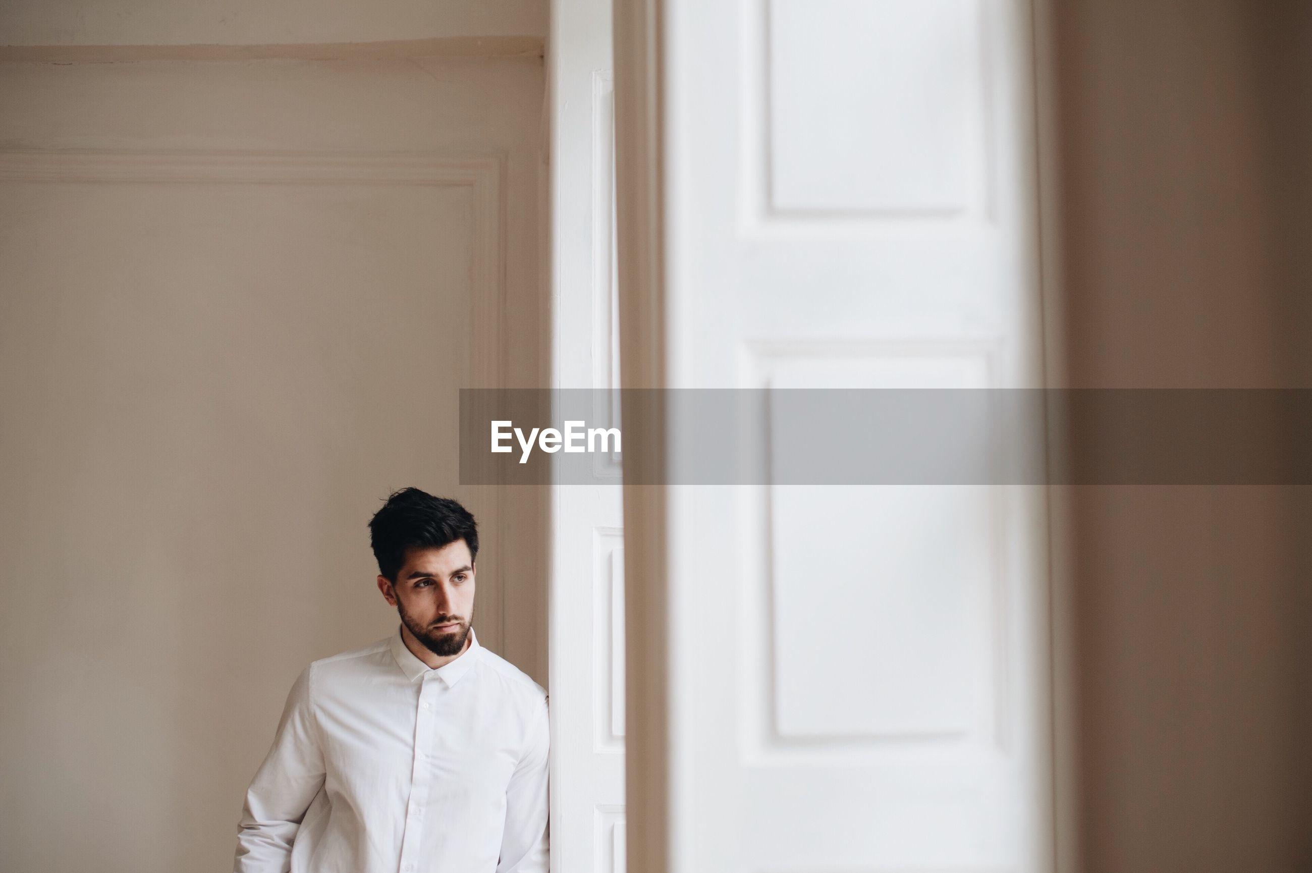 Groom standing by door