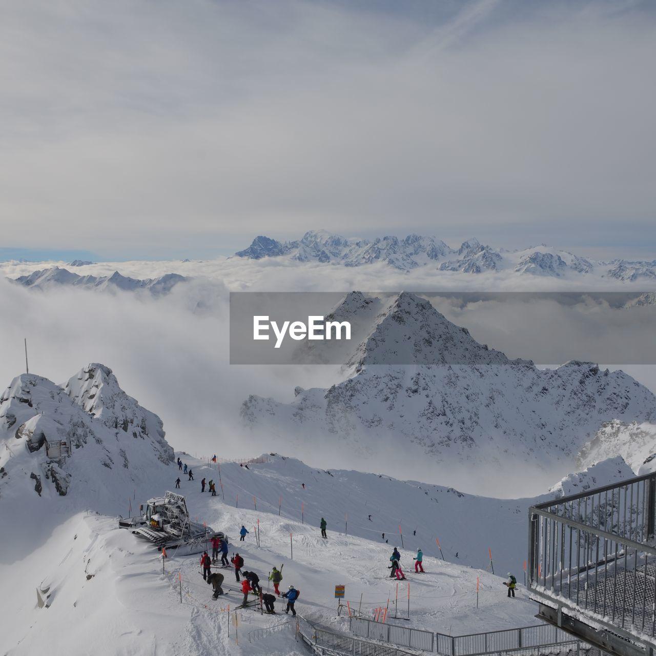 High Angle View Of Tourists At Ski Resort