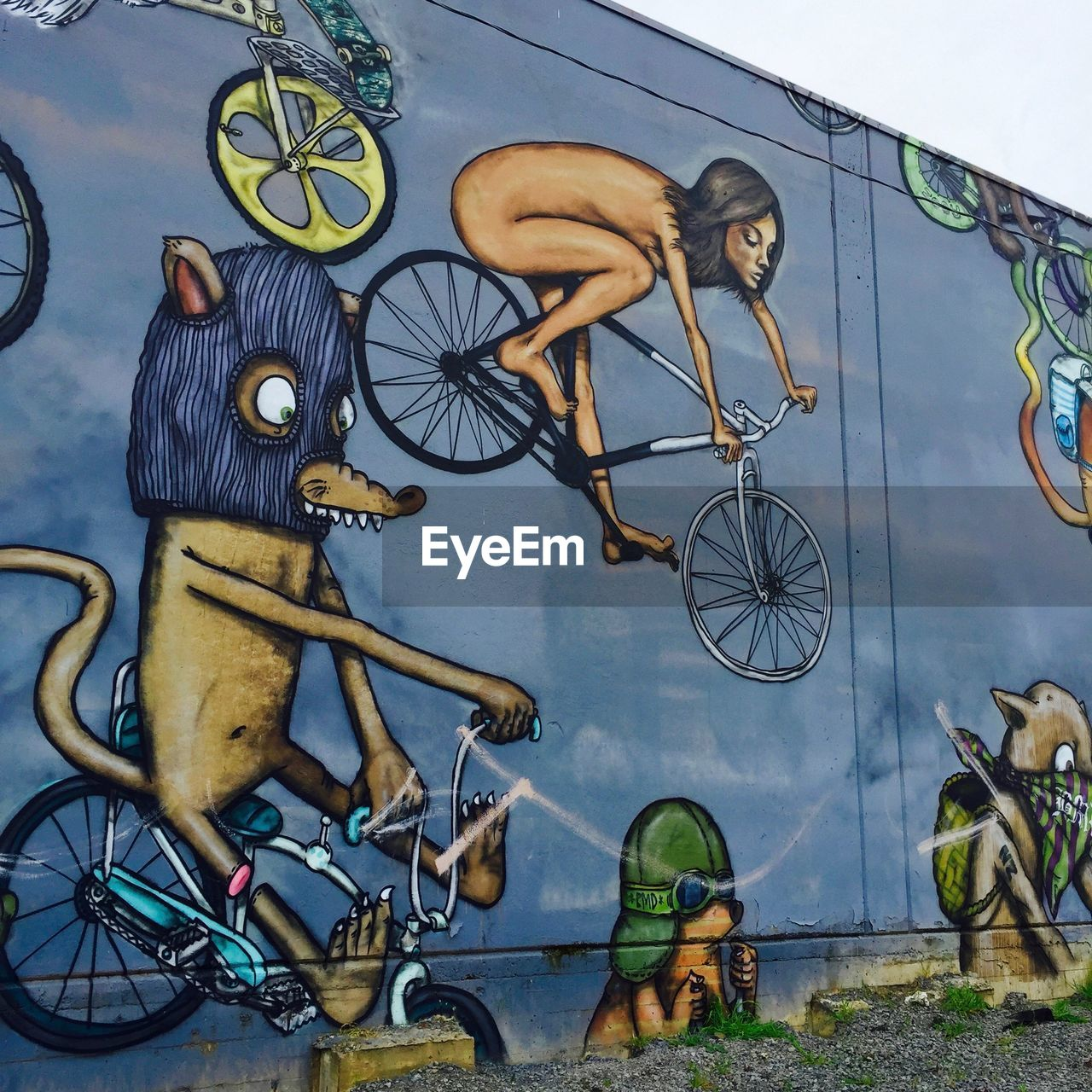 bicycle, transportation, land vehicle, mode of transportation, wall - building feature, creativity, art and craft, graffiti, men, day, lifestyles, sport, representation, people, leisure activity, human representation, real people, outdoors, male likeness, wheel, mural