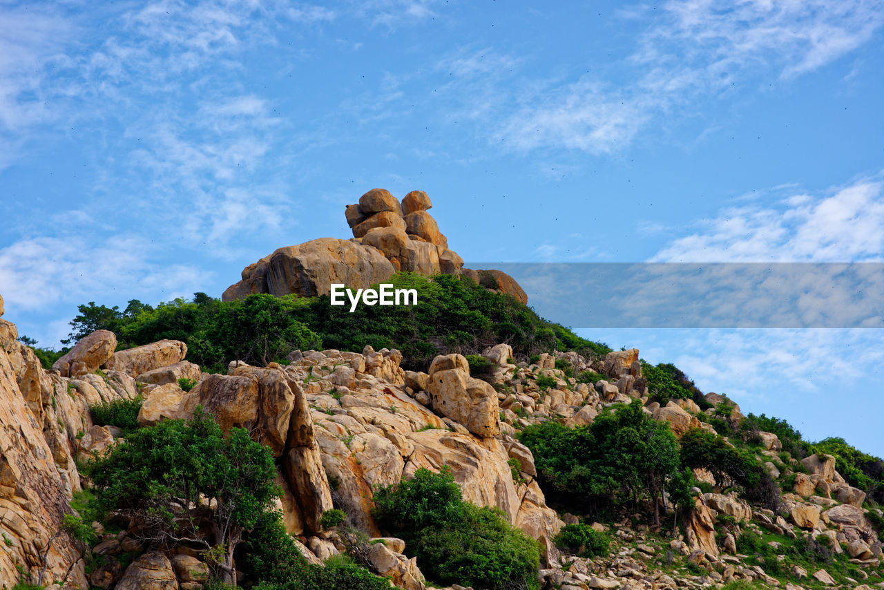 geology, tranquil scene, rock - object, nature, rock hoodoo, day, travel destinations, no people, sky, cloud - sky, outdoors, low angle view, tranquility, physical geography, beauty in nature, scenics, arid climate, landscape, mountain, tree