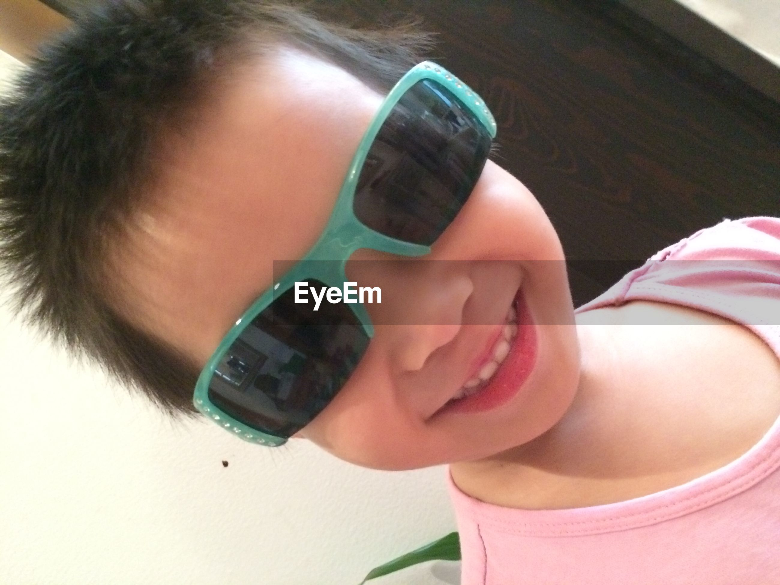 holding, lifestyles, person, leisure activity, childhood, high angle view, indoors, part of, close-up, cropped, human finger, toy, unrecognizable person, personal perspective, sunglasses, nail polish