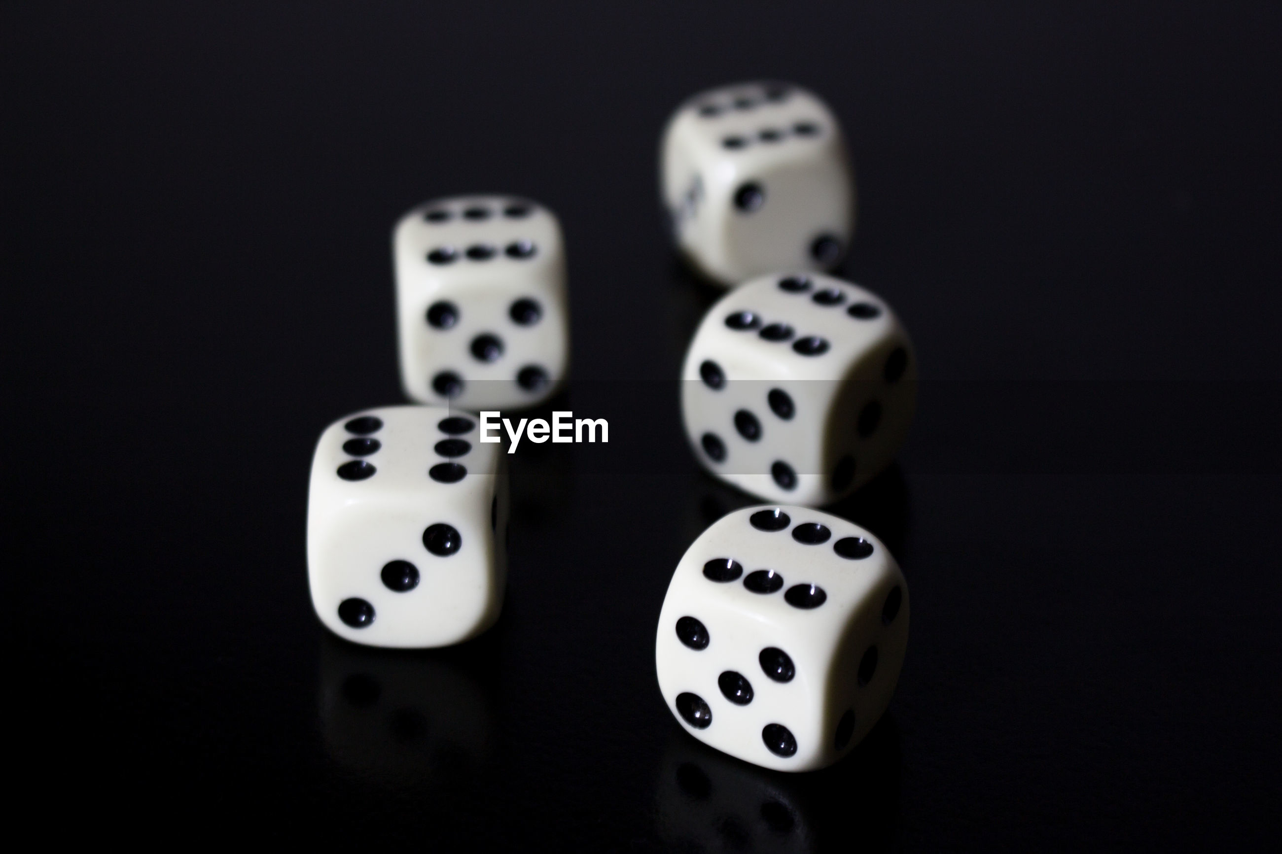 High angle view of dices on black background