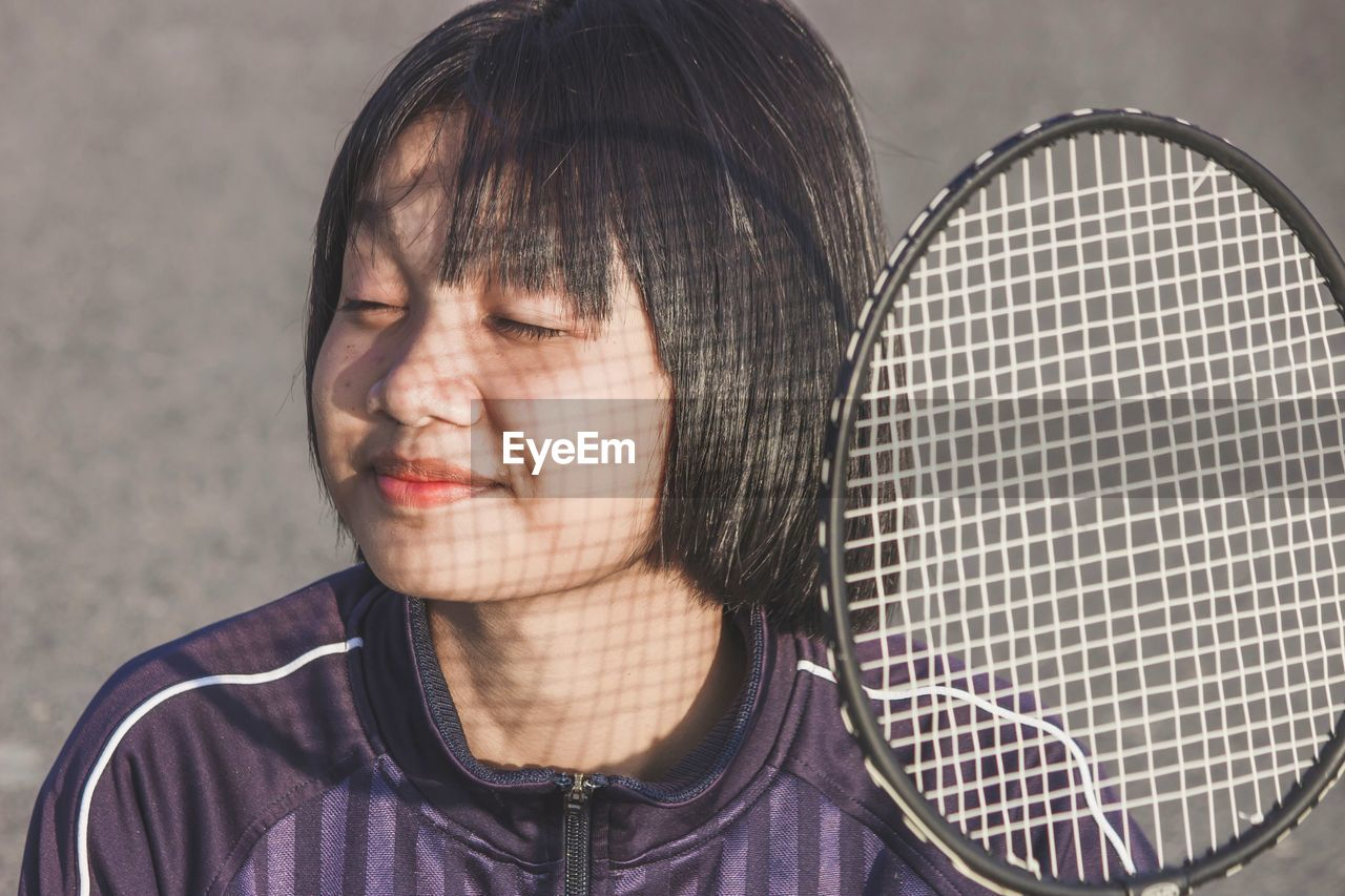 New normal lifestyle, free from disease. portrait of young woman with badminton racket.