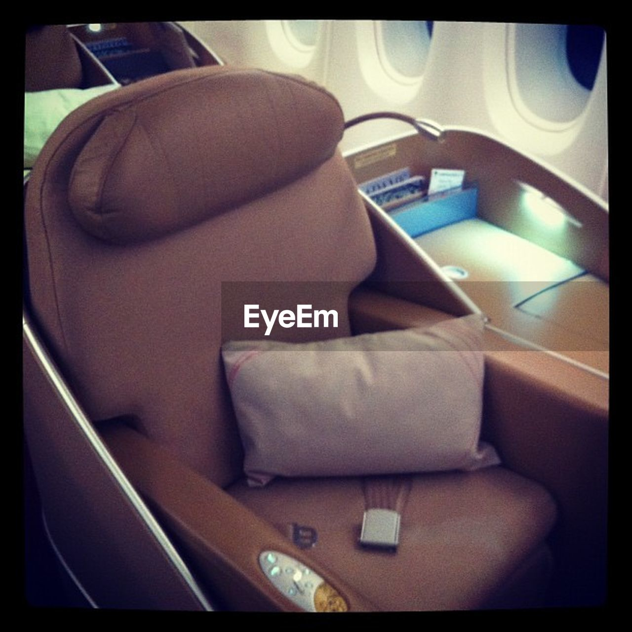 indoors, vehicle seat, chair, no people, technology, seat, close-up, airplane, day