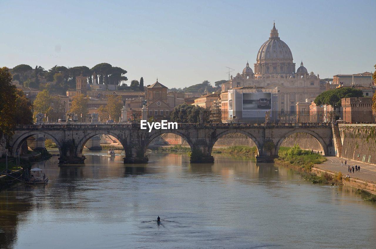 Ponte Sant Angelo Over Tiber River Against St Peter Basilica