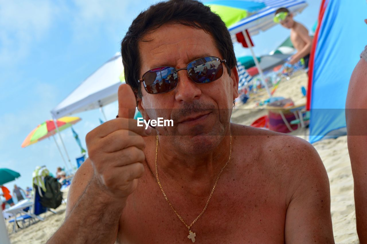 one person, real people, front view, headshot, glasses, portrait, leisure activity, sunglasses, lifestyles, focus on foreground, fashion, day, shirtless, adult, nature, senior adult, human body part, mature adult, outdoors, human face, hairstyle