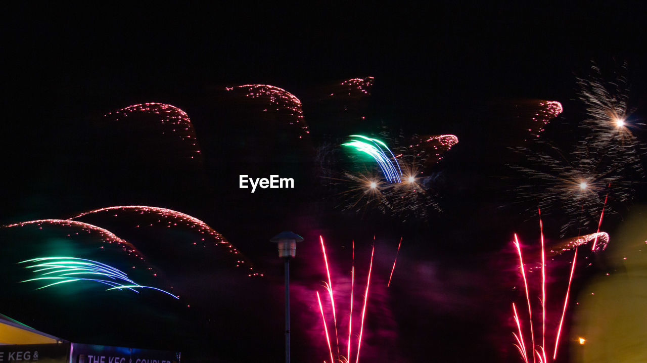 night, illuminated, firework, celebration, firework display, arts culture and entertainment, glowing, motion, event, sky, long exposure, low angle view, exploding, multi colored, no people, firework - man made object, blurred motion, light, sparks, nature, outdoors, nightlife