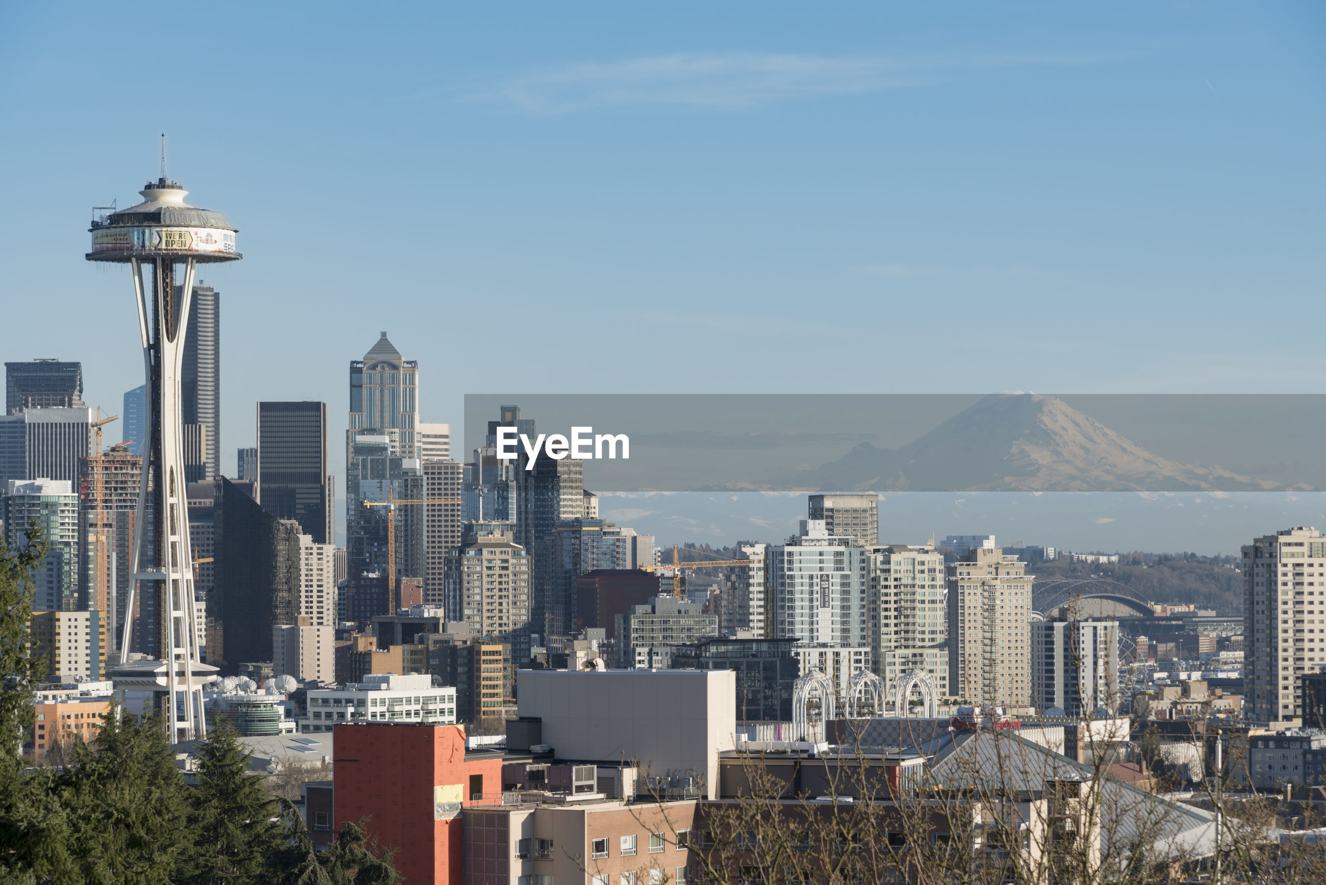 Space needle and buildings in city against sky