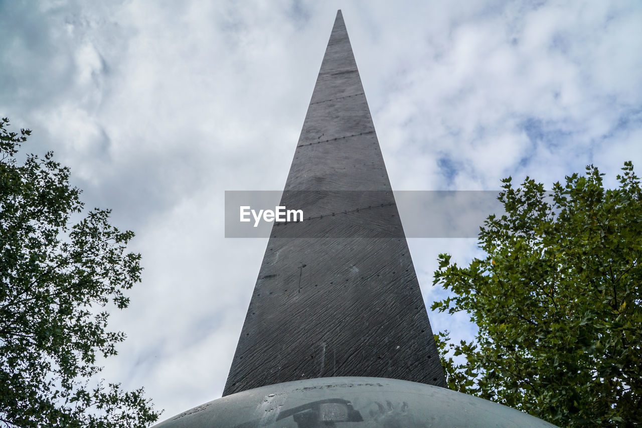 art and craft, low angle view, statue, human representation, history, sky, architecture, tree, monument, day, built structure, cloud - sky, sculpture, memorial, pyramid, travel destinations, no people, outdoors