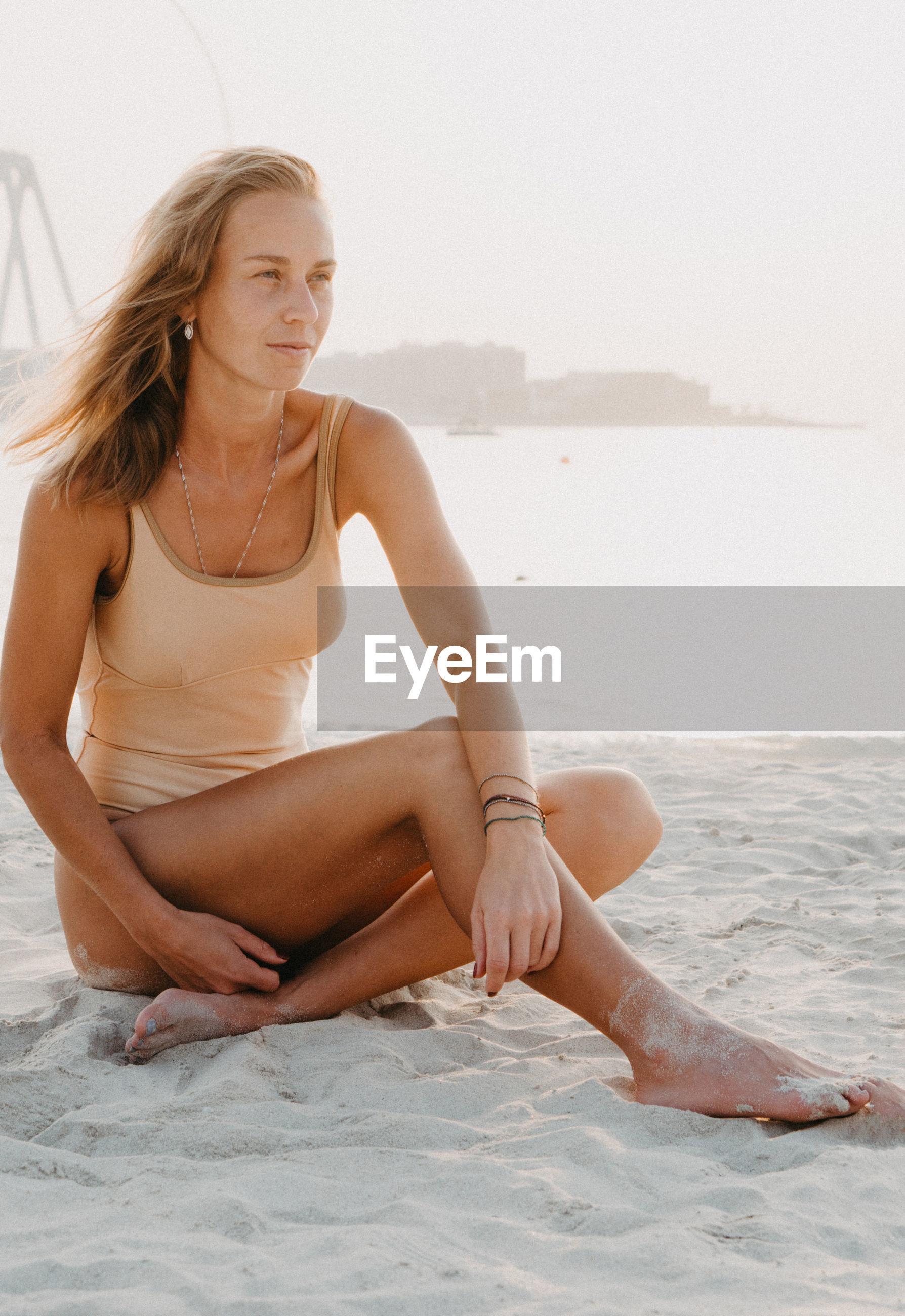 Woman sitting at beach