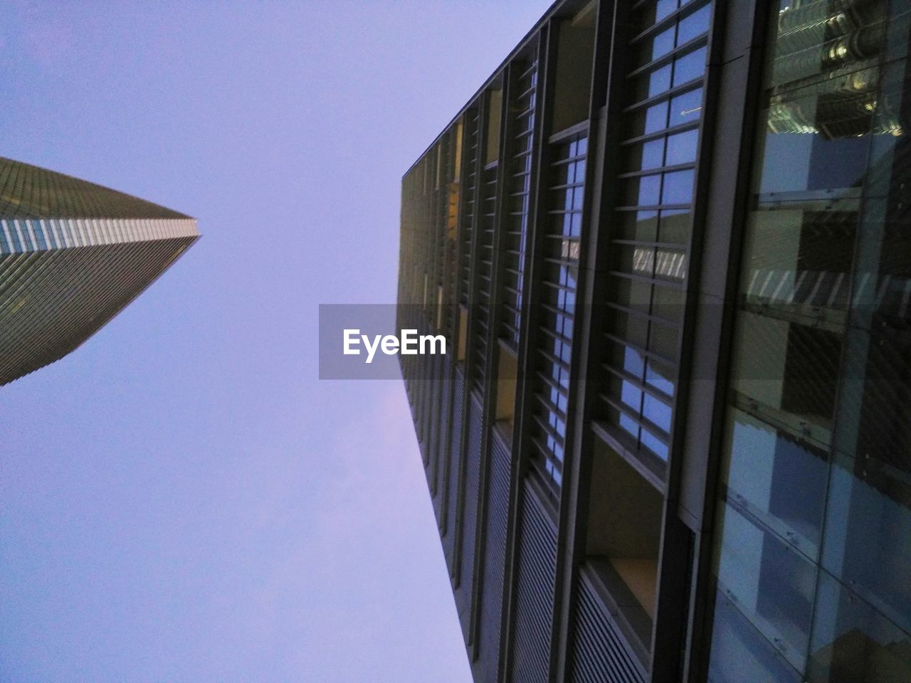 architecture, built structure, building exterior, modern, low angle view, city, skyscraper, clear sky, no people, outdoors, day, sky, blue, growth