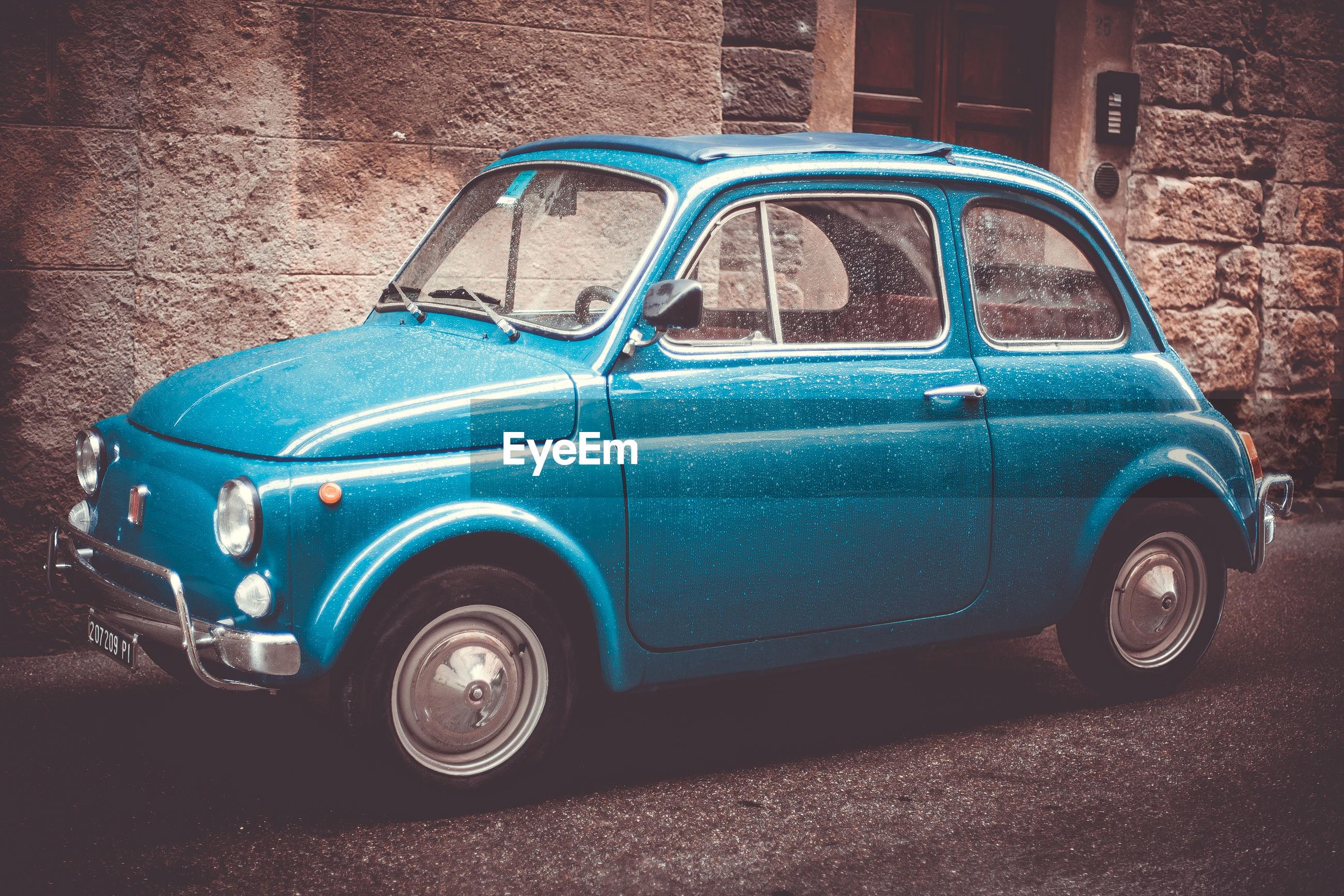 BLUE CAR ON STREET
