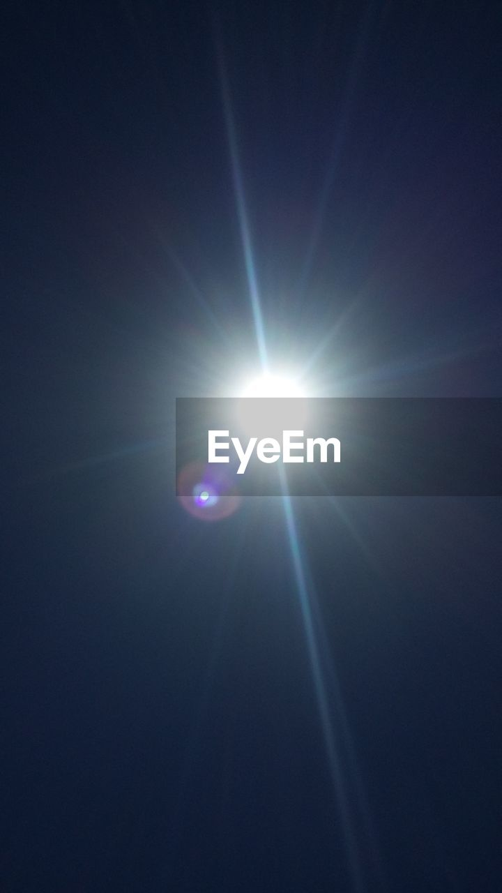 sun, lens flare, sunbeam, shining, beauty in nature, nature, no people, moon, solar eclipse, sunlight, low angle view, scenics, outdoors, sky, astronomy, day