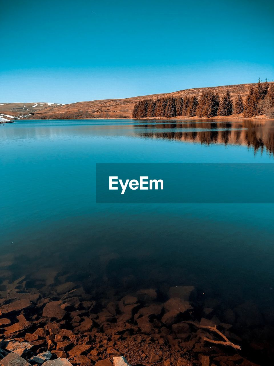 water, tranquility, scenics - nature, tranquil scene, sky, beauty in nature, lake, nature, no people, non-urban scene, day, land, blue, mountain, reflection, clear sky, idyllic, solid, rock, outdoors, arid climate, turquoise colored