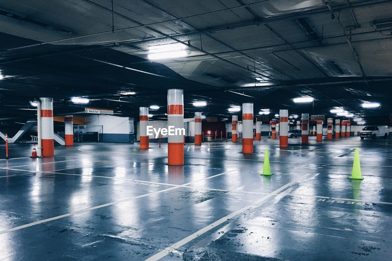 parking lot, illuminated, parking garage, transportation, no people, architectural column, architecture, built structure, traffic cone, indoors, day