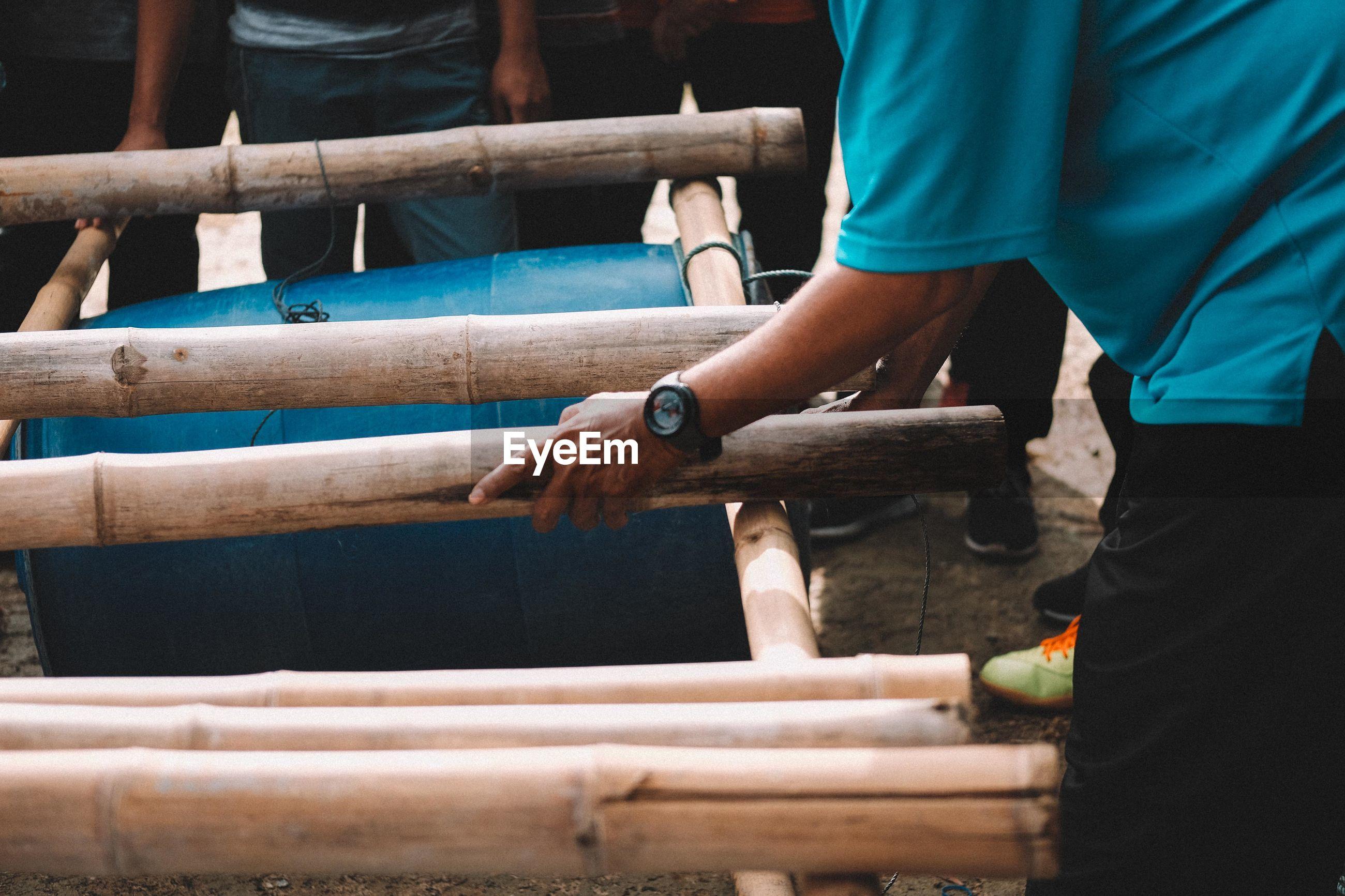 People making barrel raft