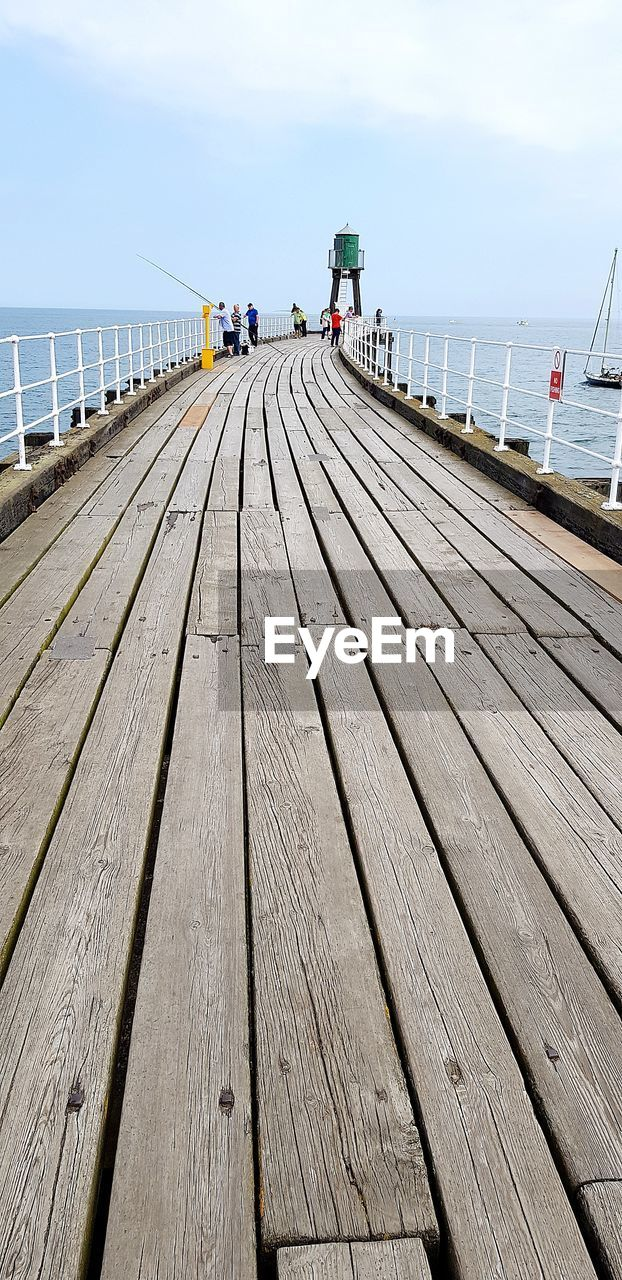 water, sky, wood - material, sea, pier, the way forward, direction, nature, boardwalk, day, footpath, diminishing perspective, railing, transportation, built structure, outdoors, wood paneling, architecture, wood, horizon over water, no people, surface level