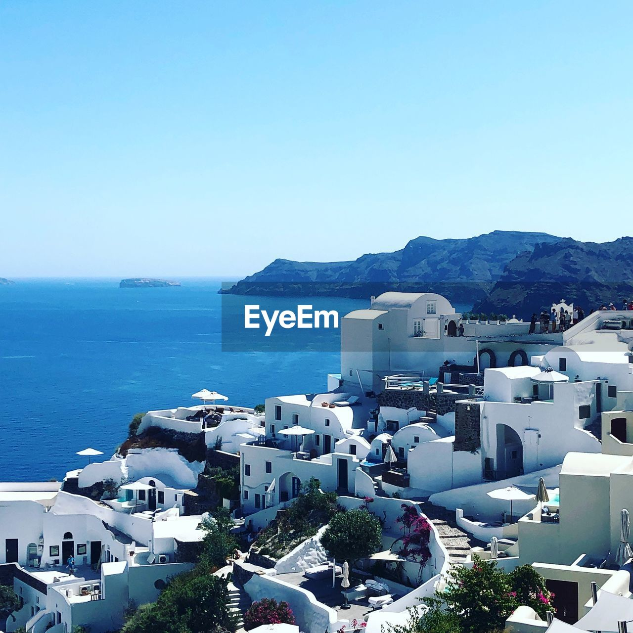sea, sky, water, building exterior, architecture, built structure, copy space, nature, blue, building, city, day, mountain, high angle view, no people, clear sky, residential district, scenics - nature, horizon over water, outdoors