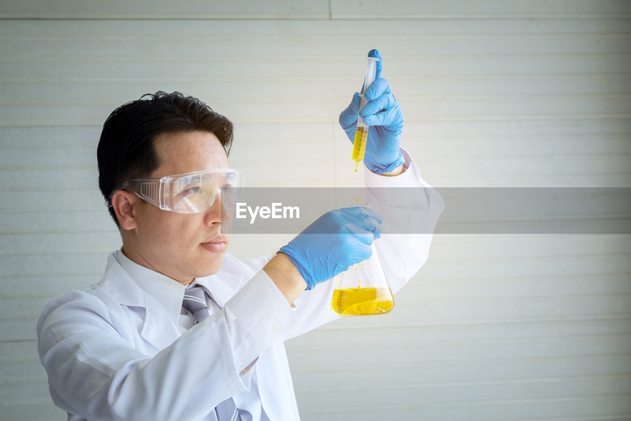 Male scientist analyzing chemical in laboratory