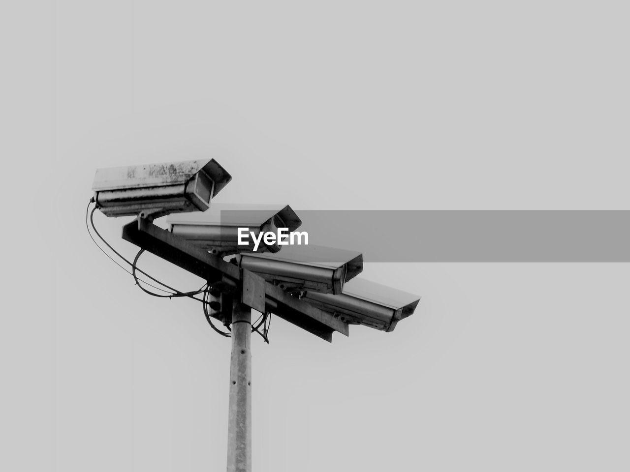 Surveillance Cameras Against Sky