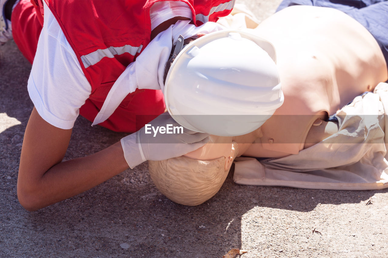 Paramedic performing cpr on dummy