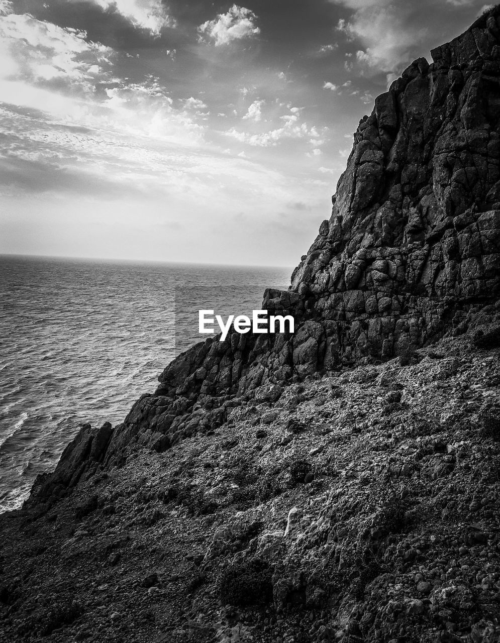 sea, sky, rock, water, horizon over water, horizon, cloud - sky, scenics - nature, rock - object, beauty in nature, solid, tranquil scene, tranquility, cliff, rock formation, land, nature, no people, day, outdoors, formation, rocky coastline, eroded
