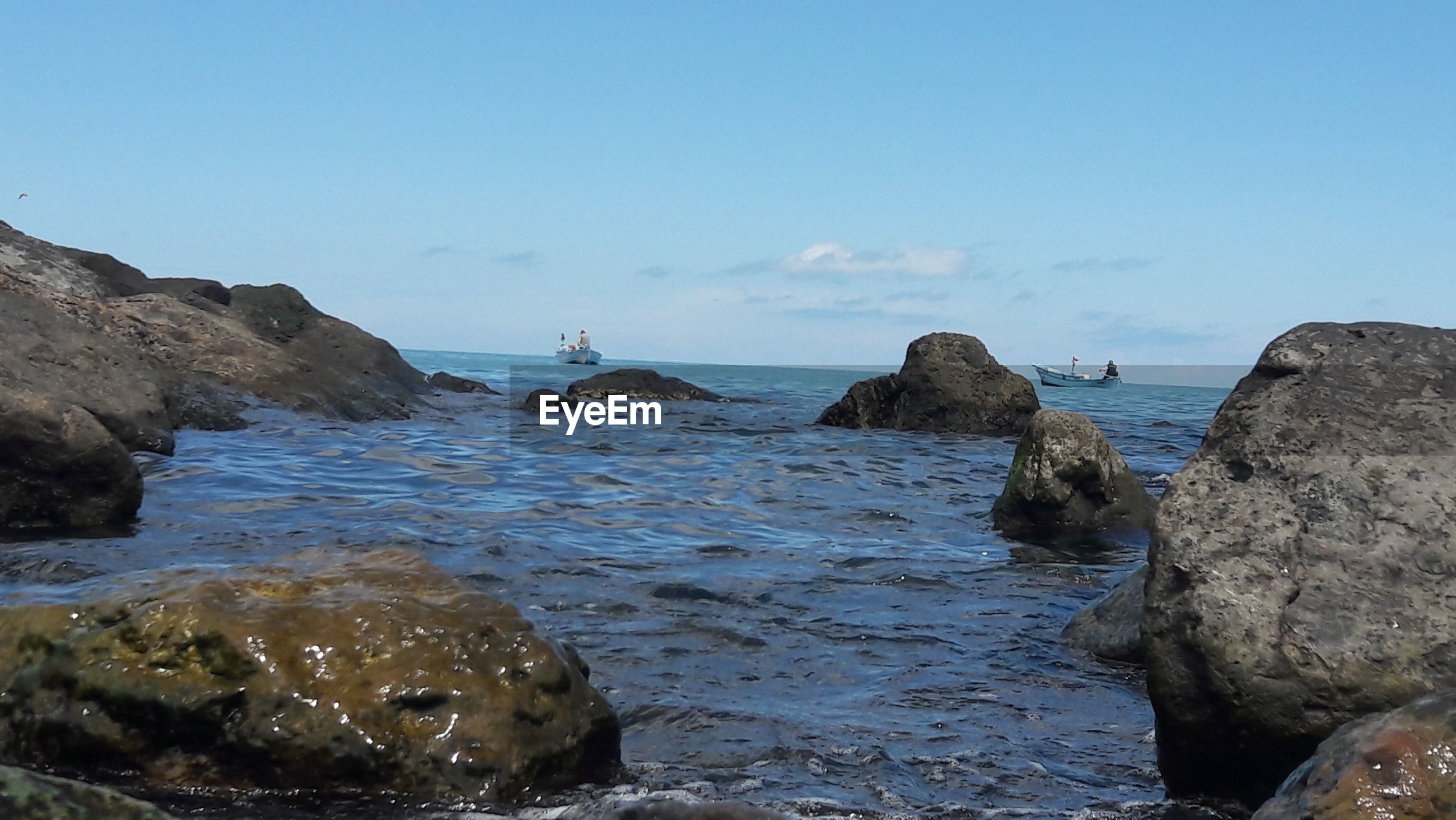 sea, rock - object, nature, water, beauty in nature, sky, scenics, outdoors, tranquility, no people, blue, day, clear sky, horizon over water