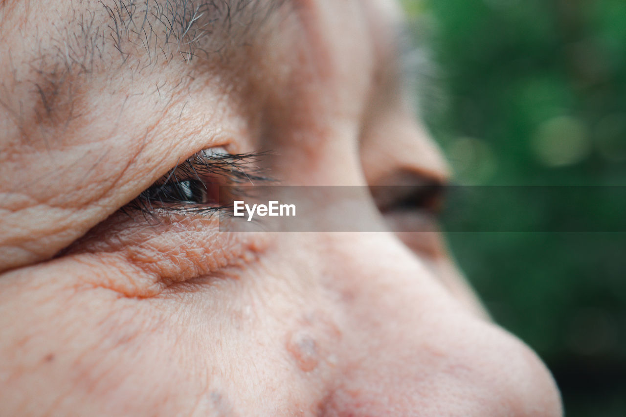 Close-up photo of a senior woman eyes. selective focus. concept of old people and body part