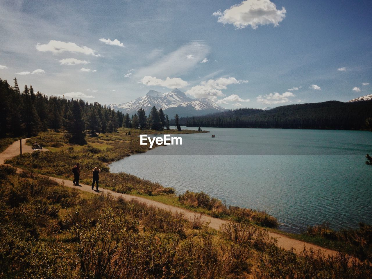 High Angle View Of People On Footpath By Lake At Jasper National Park