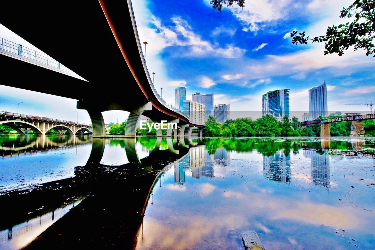 Below view of bridges over river in city