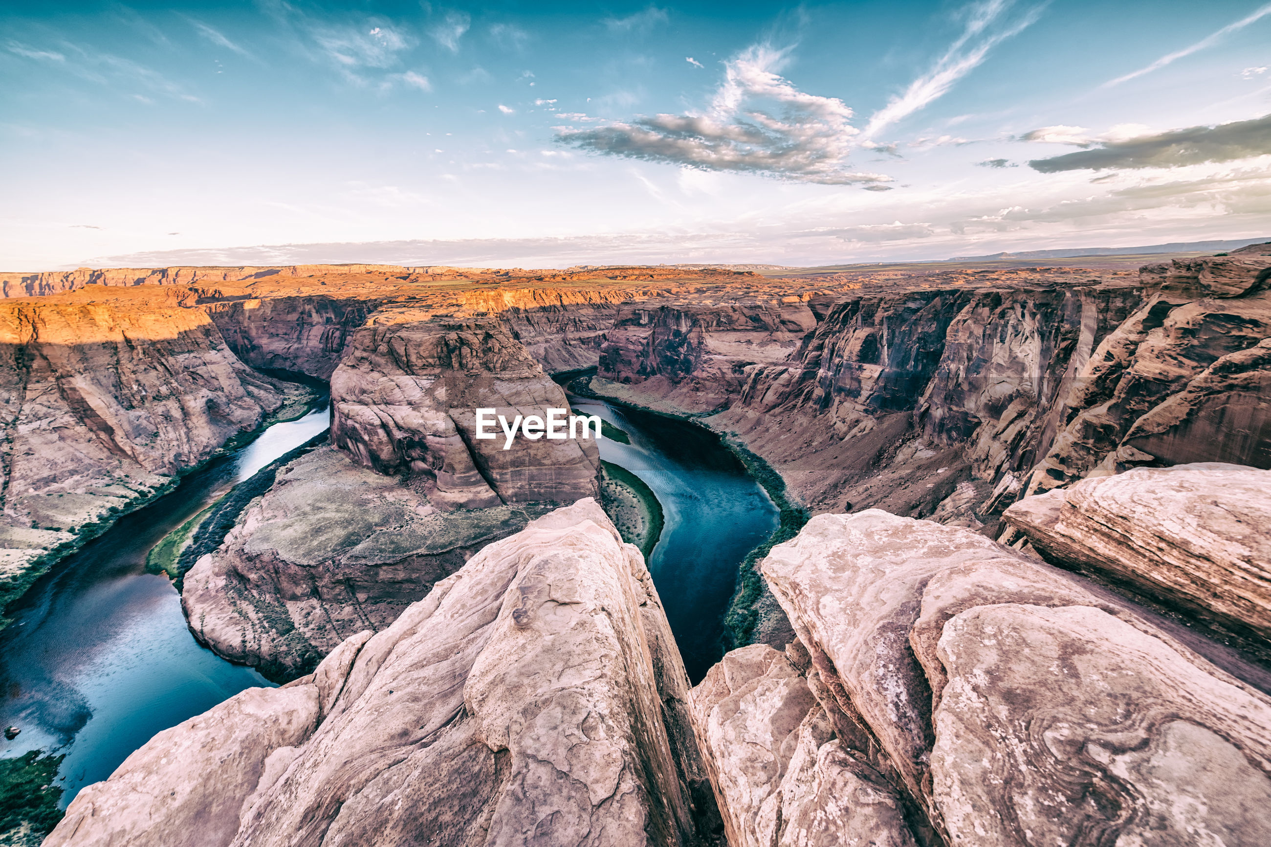 SCENIC VIEW OF ROCKS AGAINST SKY