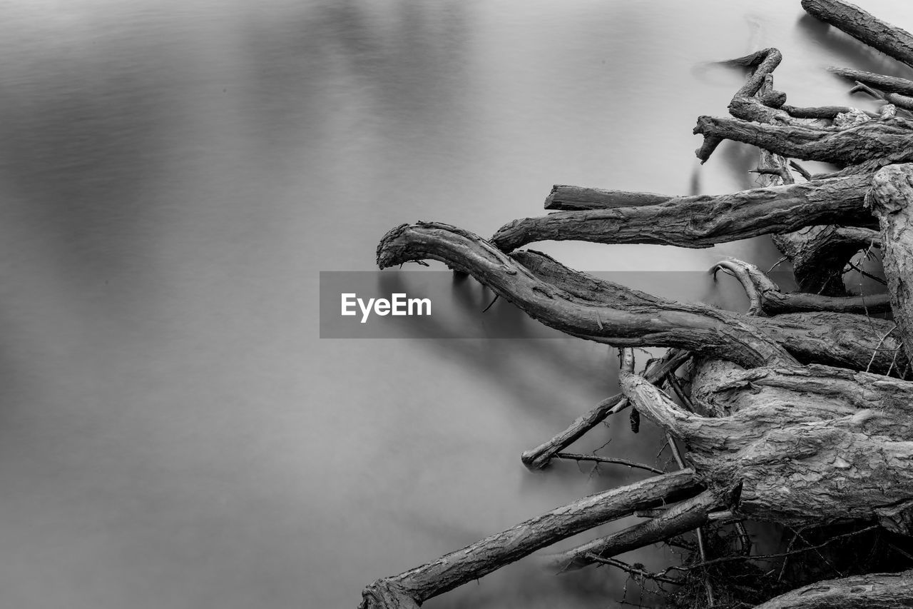 water, rope, no people, nature, day, lake, metal, close-up, transportation, focus on foreground, outdoors, nautical vessel, tied up, strength, mode of transportation, rusty, tranquility, tied knot