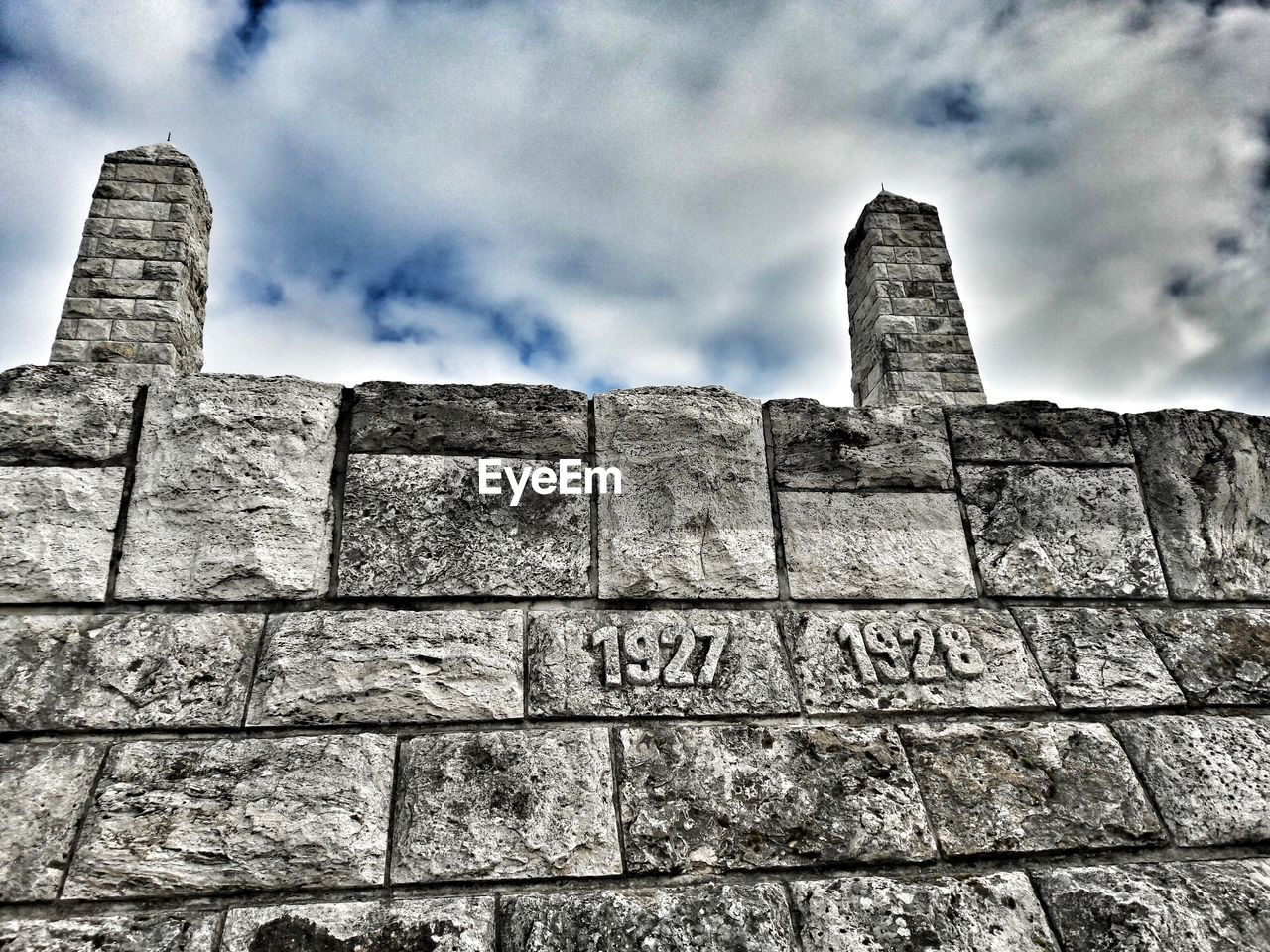 architecture, built structure, history, low angle view, cloud - sky, building exterior, ancient civilization, sky, old ruin, stone material, day, ancient, brick wall, outdoors, castle, no people