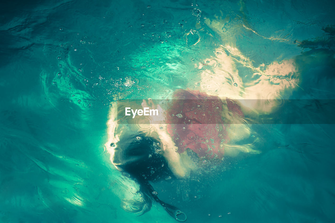 High Angle View Of Woman Swimming Underwater