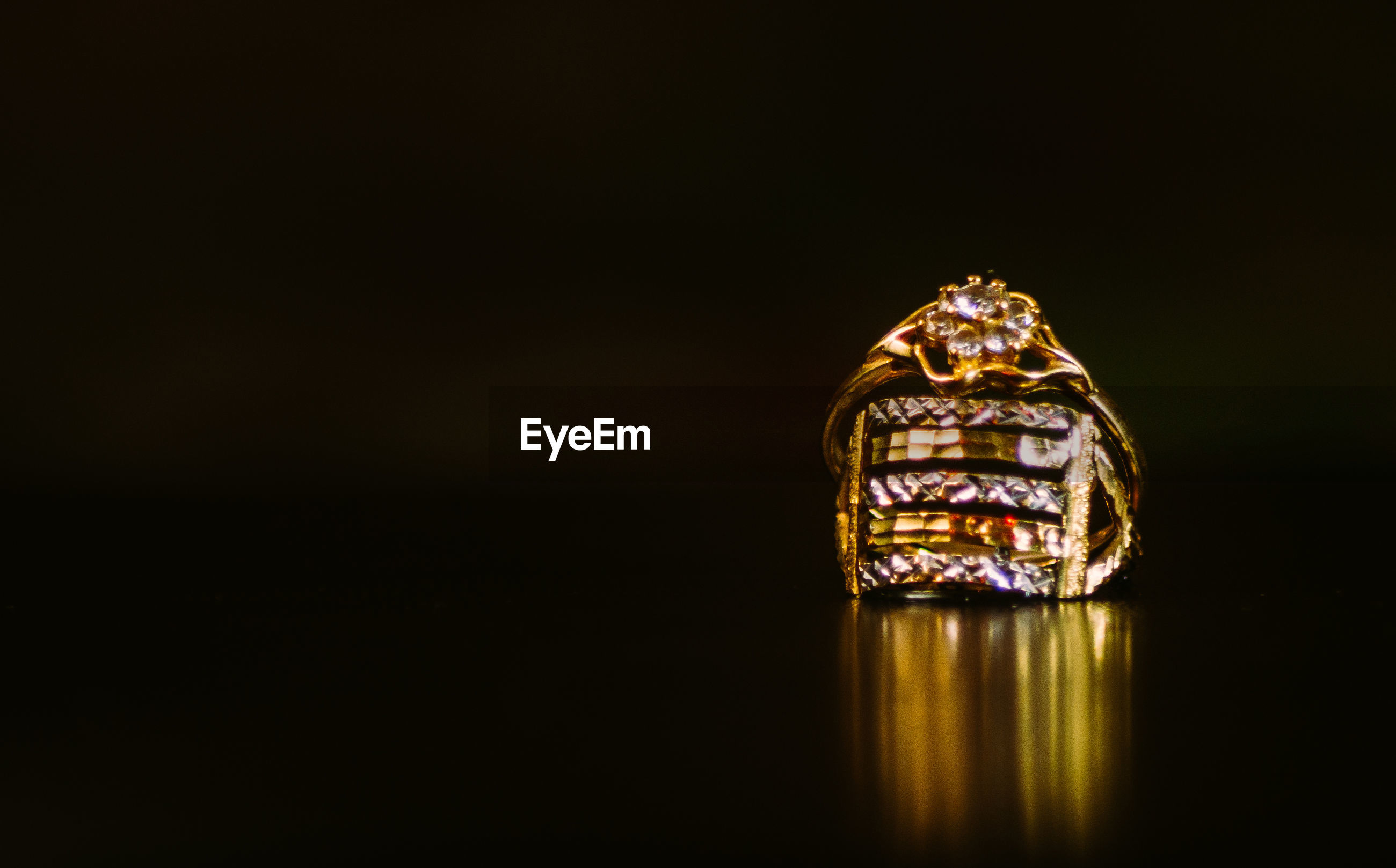 Close-up of engagement rings against black background