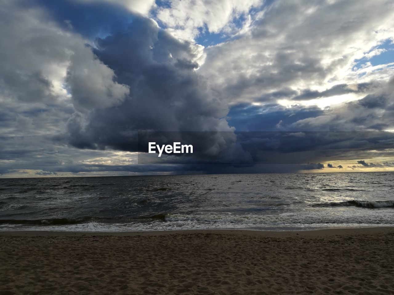 sea, cloud - sky, sky, beach, nature, beauty in nature, water, horizon over water, scenics, power in nature, no people, sand, outdoors, tranquil scene, tranquility, wave, day, storm cloud
