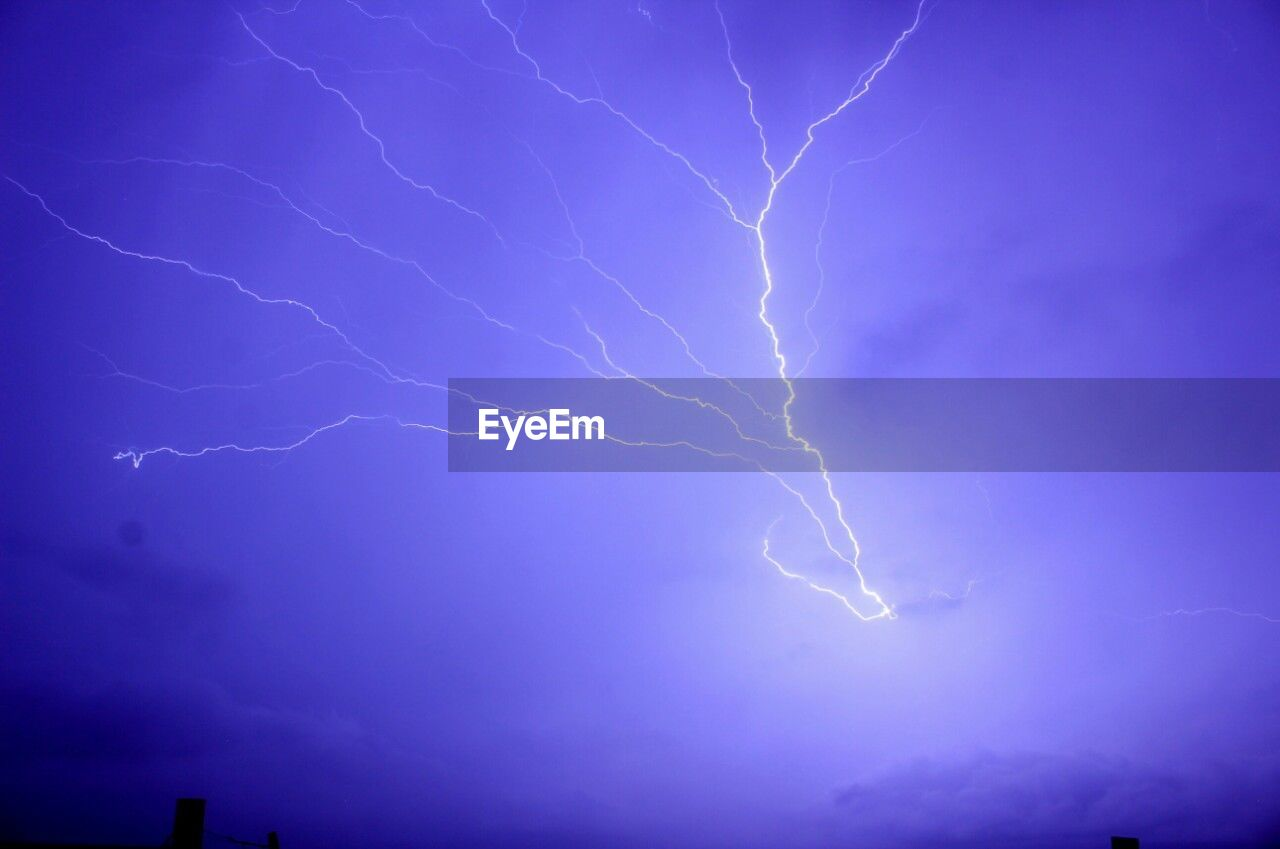 lightning, power in nature, cloud - sky, storm, power, thunderstorm, sky, beauty in nature, forked lightning, night, low angle view, illuminated, no people, nature, dramatic sky, electricity, storm cloud, light - natural phenomenon, light, outdoors, purple