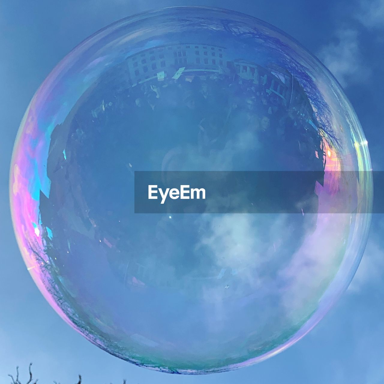 bubble, transparent, sphere, no people, nature, vulnerability, close-up, geometric shape, fragility, reflection, shape, sky, glass - material, day, blue, soap sud, circle, outdoors, mid-air, low angle view
