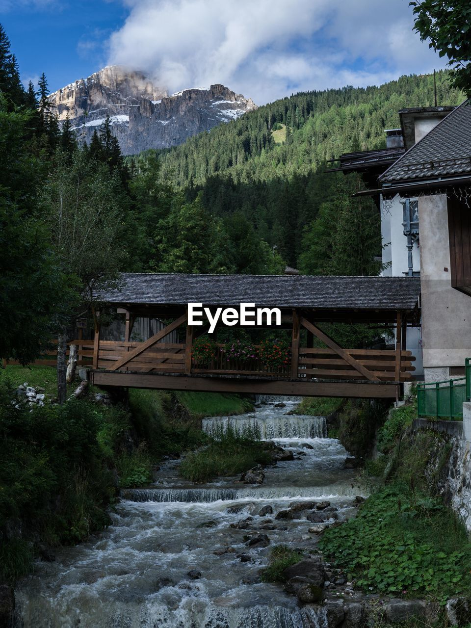 built structure, architecture, mountain, plant, tree, water, no people, bridge, nature, sky, scenics - nature, cloud - sky, bridge - man made structure, day, beauty in nature, building exterior, connection, motion, forest, flowing water, flowing